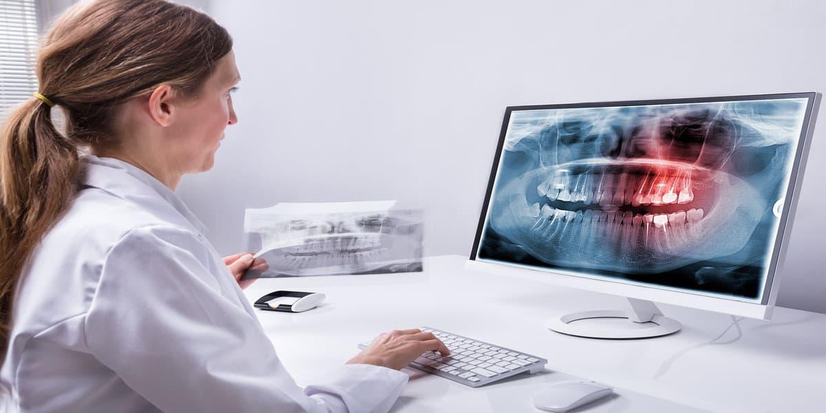 rsz bigstock mature female dentist looking 242204008 New Hamburg Dental Group